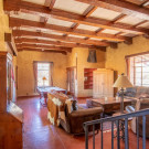 This room is yours when you rrent the couple Ranch home. Great Room with hand hued massive beams and corbels